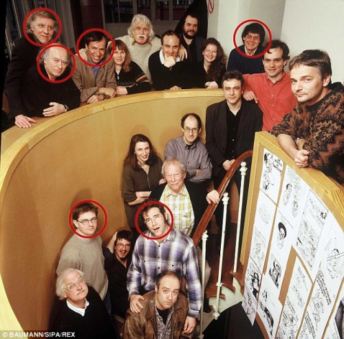 Six of the Charlie Hebdo staff killed in Wednesday's attack are pictured together in this photo, taken in 2000. Circled top from left is Philippe Honore, Georges Wolinski, Bernard Maris and Jean Cabut. Below them on the stairs, from left, is editor Stephane Charbonnier and cartoonist Bernard 'Tignous' Verlhac.