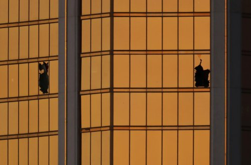 Morning light reflects off the Mandalay Bay hotel and the broken windows where shooter Stephen Paddock conducted his shooting spree from the 32nd floor in Las Vegas, Nevada