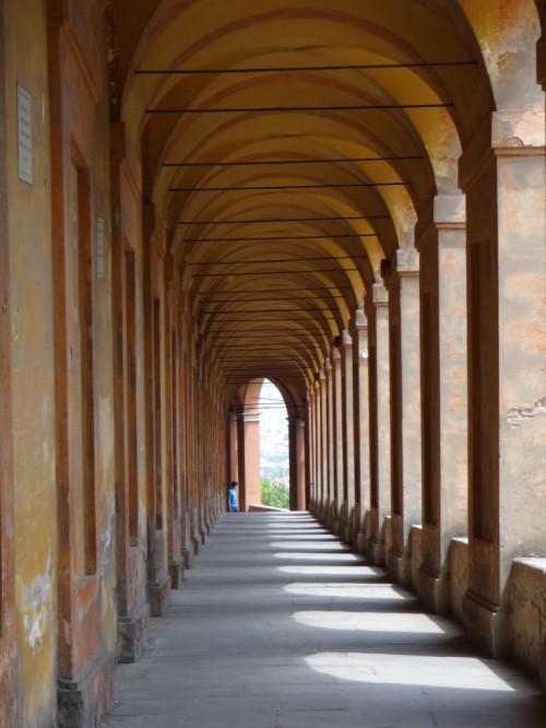 Bologna-Portico-di-San-Luca-around-arch-565-view-at-end-with-person-standing-by-768x1024